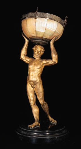 A GILT-BRONZE FIGURE OF ATLAS SUPPORTING A SILVER-MOUNTED MOTHER-OF-PEARL BOWL