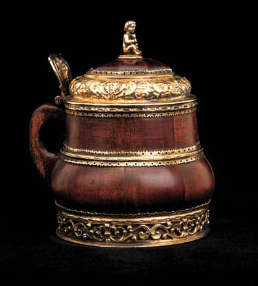 A GERMAN SILVER-GILT MOUNTED MINIATURE PINE AND FRUITWOOD TANKARD