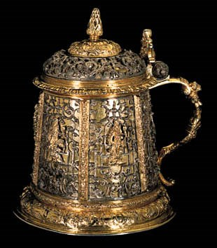 A GERMAN PARCEL-GILT TANKARD