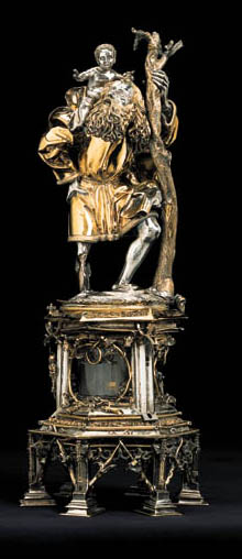 A GERMAN LATE GOTHIC PARCEL-GILT STATUETTE OF SAINT CHRISTOPHER ON RELIQUARY BASE