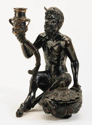 A BRONZE GROUP OF A CANDLESTIC