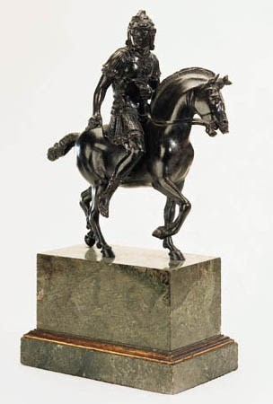 A BRONZE EQUESTRIAN GROUP OF '