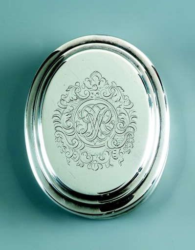 A Queen Anne silver tobacco-bo