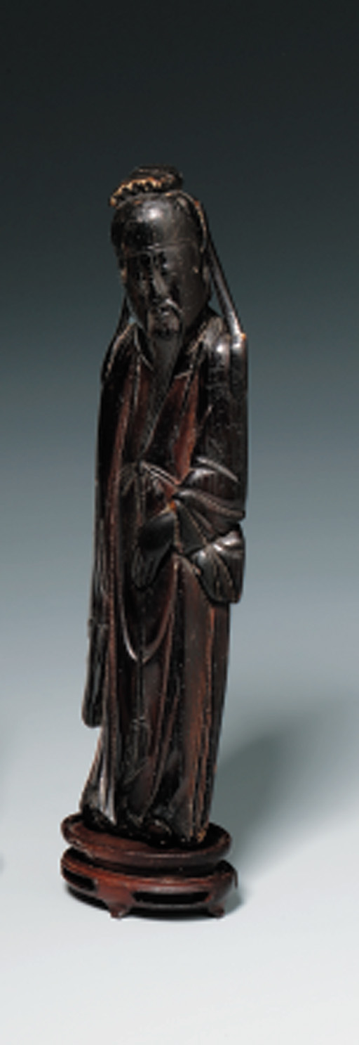 A STAINED IVORY FIGURE