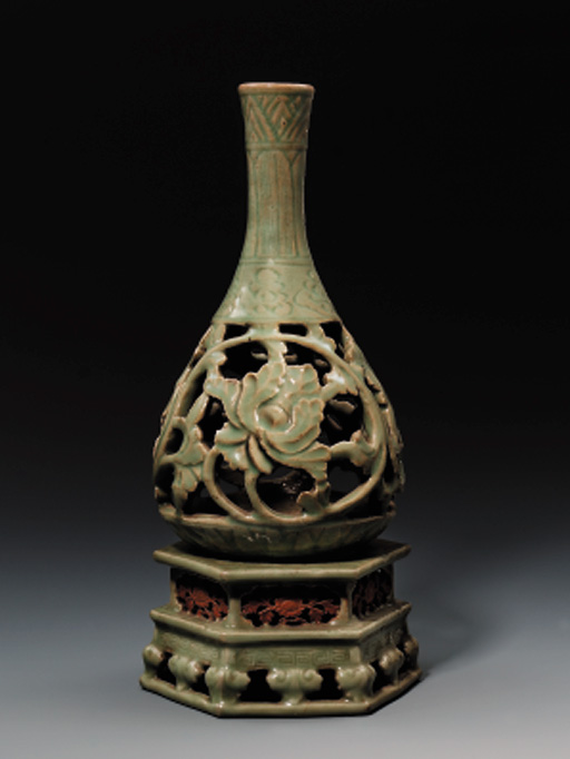A PIERCED LONGQUAN CELADON BOTTLE VASE AND STAND