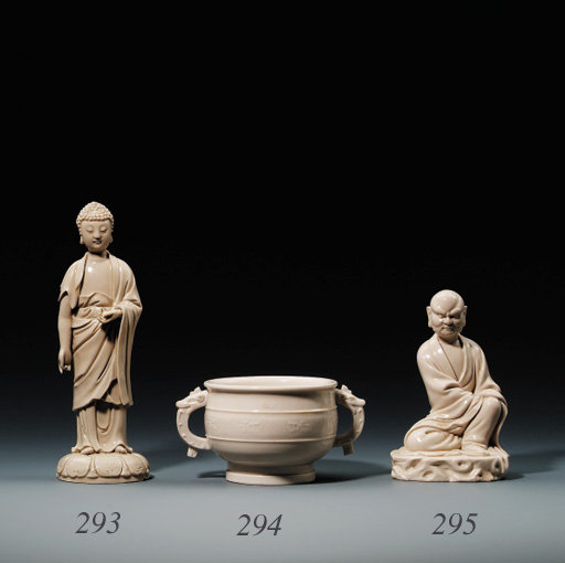 A DEHUA BLANC-DE-CHINE STANDING BUDDHA