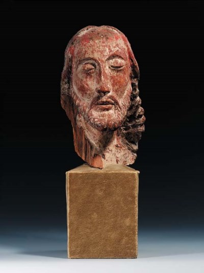 A FRAGMENTARY CARVED WOOD HEAD