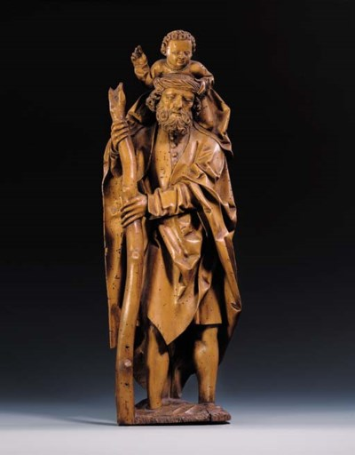 A CARVED WOOD GROUP OF SAINT C