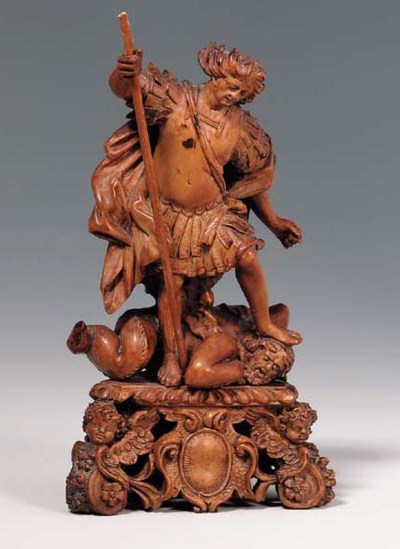 A CARVED WOOD GROUP OF SAINT M