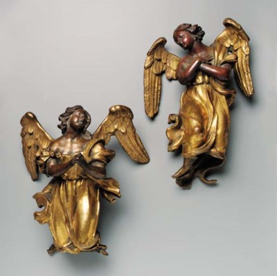 A PAIR OF PARCEL-GILT BRONZE A