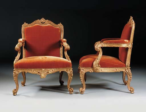 A PAIR OF GEORGE II GILTWOOD ARMCHAIRS
