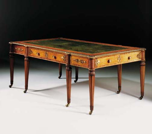 A REGENCY BRASS-INLAID AND ORMOLU-MOUNTED MAHOGANY WRITING-TABLE