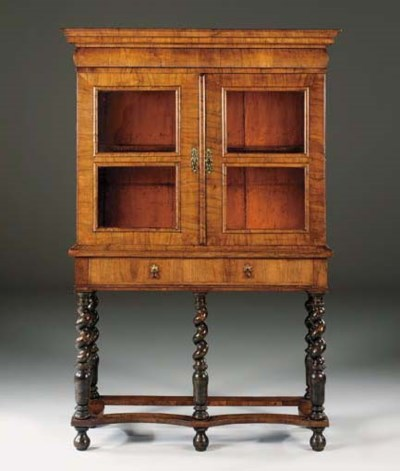 A WALNUT CABINET-ON-STAND