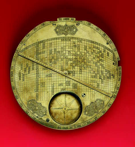 ISLAMIC MECCA-CENTRED WORLD MAP--A rare and important 17th-century Safavid brass world map from Isfahan [International Instrument Checklist #8024], the finely-engraved circular map plate with a centrally-pivoted brass diametrical rule rotating over it, with a compass box inset into the plate, 2 turned brass feet attached to the underside of the plate. (One foot a skilful modern replacement, lacking needle, glass, folding dial, and latitude arc). Diameter: 225mm.