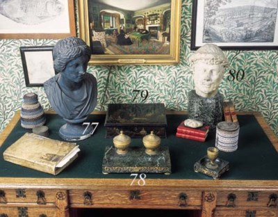 AN ENGLISH PATINATED SCULPTED