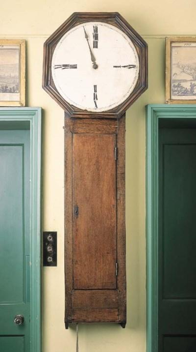 An oak drop-dial wall timepiec