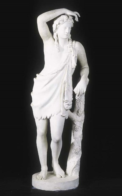 A white-painted plaster statue
