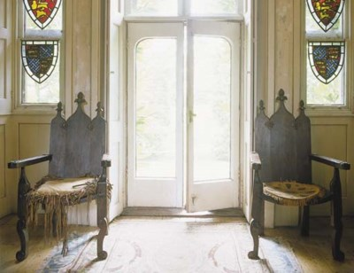 A pair of English oak armchair