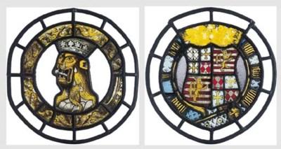 A pair of circular heraldic st