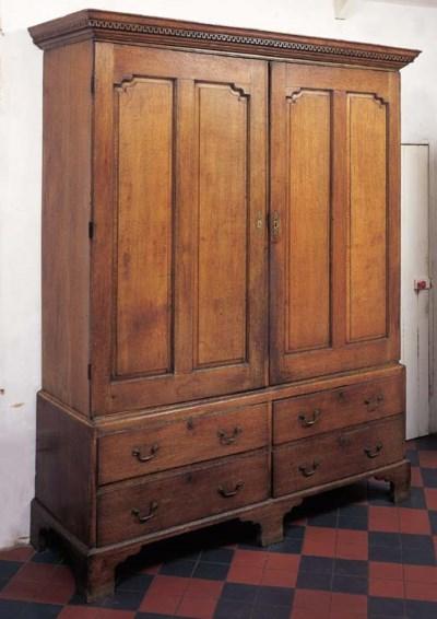 A pair of George III oak linen