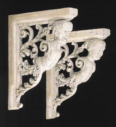 A pair of cream-painted carved