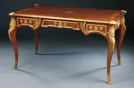 A Napoleon III ormolu-mounted kingwood bureau plat