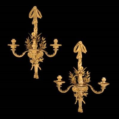 A set of four gilt-bronze thre