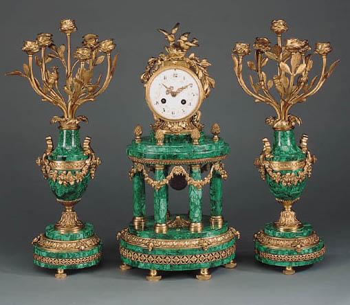 A gilt-bronze and malachite clock garniture
