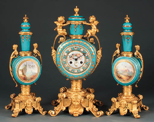 A Napoleon III ormolu-mounted parcel-gilt turquoise-ground jewelled porcelain clock garniture
