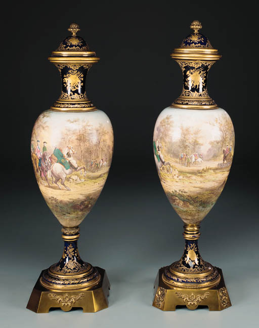 A pair of ormolu-mounted parcel-gilt blue-ground faïence vases and covers