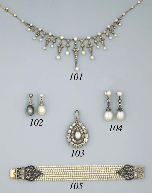 A Pair of Pearl And Diamond Ear Pendants