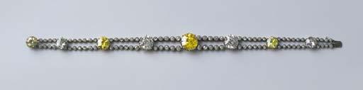 An Important Diamond And Yellow Diamond Bracelet