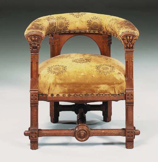 A carved oak library chair