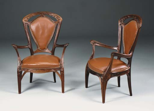 A pair of carved walnut uphols