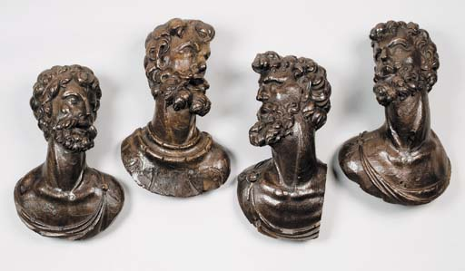 A SET OF FOUR WOOD BUSTS OF ME