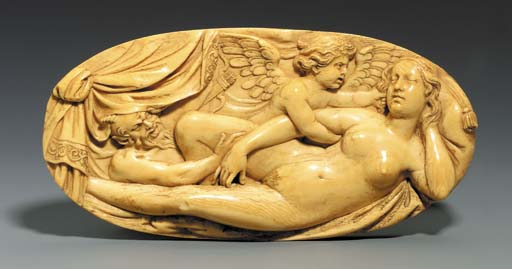 AN OVAL CARVED IVORY RELIEF DE