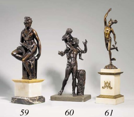 A  BRONZE GROUP OF A FAUN AND