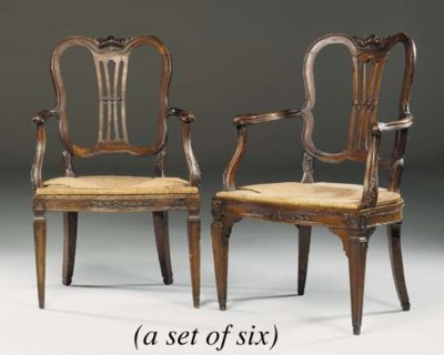 A SET OF SIX ITALIAN WALNUT AR