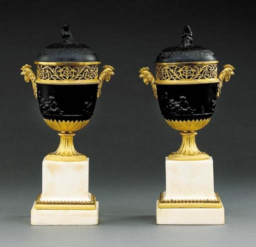 A PAIR OF FRENCH ORMOLU, BLACK BASALT AND WHITE MARBLE BRULE PARFUMS