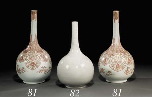 A CHINESE INCISED WHITE-GLAZED