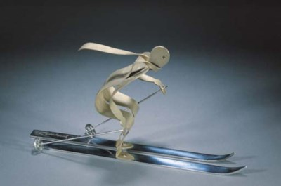 A SILVERED METAL FIGURE