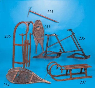 A WOODEN SLEDGE,