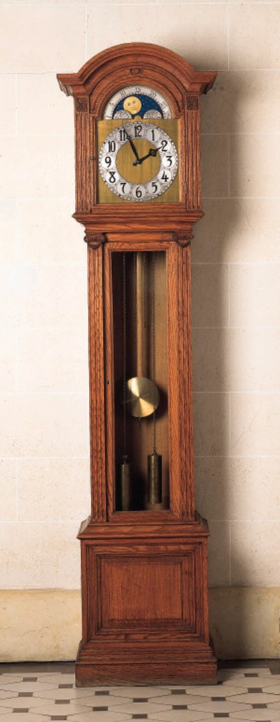 An oak longcase regulator time