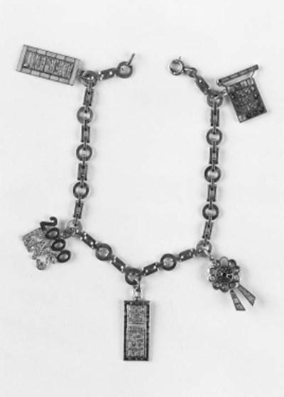 A platinum charm bracelet,