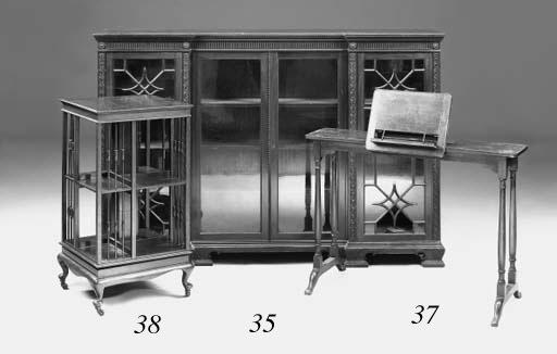 An Edwardian walnut revolving bookcase