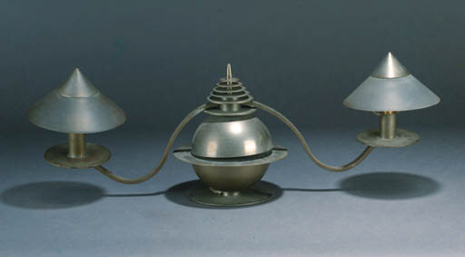 A SILVERED METAL AND GLASS CANDELABRA AND LAMP