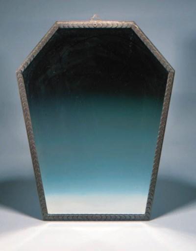 A WROUGHT-IRON WALL MIRROR