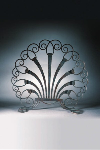 A WROUGHT-IRON FIRE-SCREEN