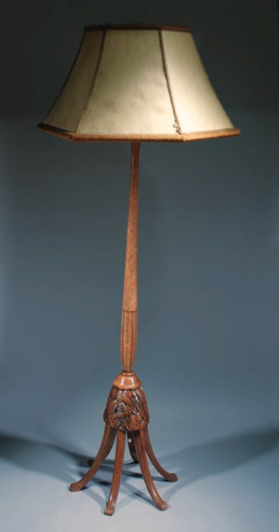 A CARVED WOOD STANDARD LAMP