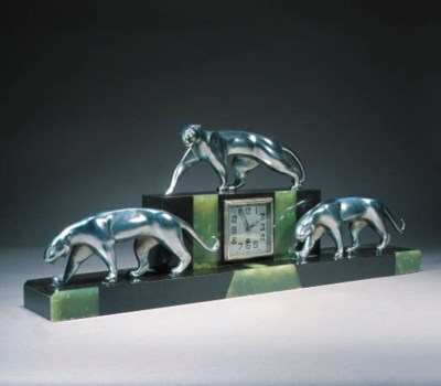 A SILVERED BRONZE AND ONYX TAB